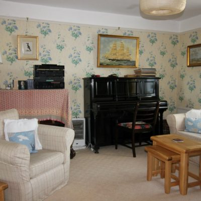 Piano end of sitting room